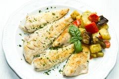 Fiskfilé med grönsaker arkivfoton