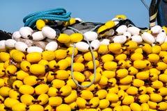 Fisknät med gula flöten på högen, slut upp Royaltyfria Foton
