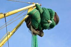 Fisknät på en trålare mot blå himmel Royaltyfri Bild