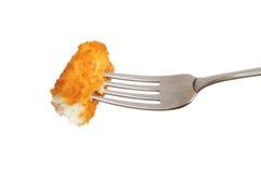 Fiskpinne på en gaffel royaltyfria foton