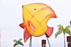 Fisksymbolen i allmänheten parkerar royaltyfri foto