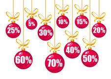Fissi delle etichette di sconto 10,15,20,25,30,40,50,60,70 per cento fuori sotto forma delle palle rosse di Natale che appendono  illustrazione di stock