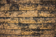 Fissures background. Background black brick orange cracks Stock Photo