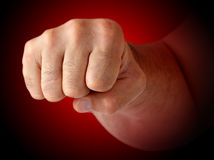 Fist. Male fist against a dark background. Marking the impact Royalty Free Stock Photos