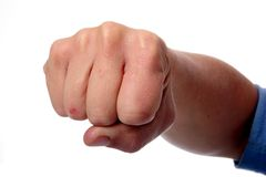 Fist. Hand with clenched fist against a white background Royalty Free Stock Photos