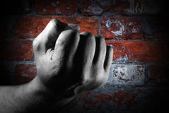 Fist against brick wall Royalty Free Stock Photography