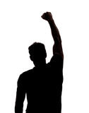 Fist in the air. In silhouette isolated over white background Royalty Free Stock Photos