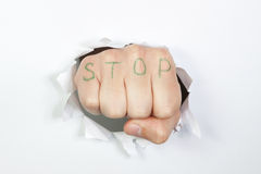 The fist on the background paper. Royalty Free Stock Photography
