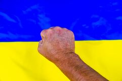 Fist on the background of the Ukrainian flag - Independence Day stock photo