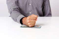 Fist on a bills of dollars Stock Photography