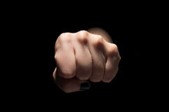 Fist on black Stock Images