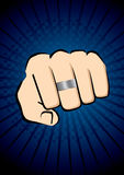 Fist in blue background Royalty Free Stock Images
