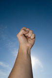 Fist with blue sky Stock Photo
