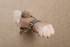Fist breaking through cardboard. Man's fist breaking through cardboard Stock Photography