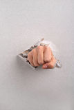 Fist breaking plasterboard Stock Photography