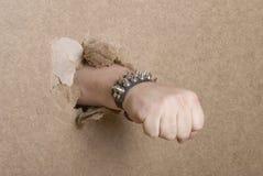 Fist Breaking Through Cardboard