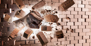 Fist Breaking Wall - Strength. At Max Power Stock Photo
