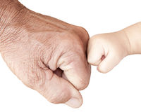 Fist bump. With hard and soft hands Stock Photos