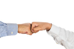 Fist bump on formal wear, gesturing an agreement and cooperation Stock Photos