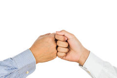 Fist bump on formal wear, gesturing an agreement and cooperation Royalty Free Stock Photo