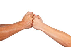 Fist Bump. A fist bump is a gesture similar in meaning to a handshake or high five. A fist bump can also be a symbol of giving respect Royalty Free Stock Images