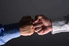 Fist bump handshake between businessmen Royalty Free Stock Photos