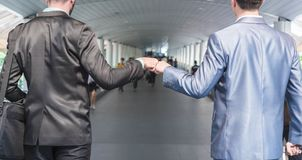 Fist Bump of two businessman stock photo