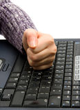 Fist on computer keyboard Royalty Free Stock Photo
