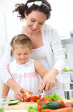 Fist cooking lesson Stock Images