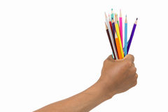 Fist with crayons on a white background. The power of education to success, delightful fun Royalty Free Stock Photography