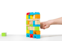 Fist destroying house made of color wooden blocks Stock Image
