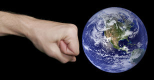Fist And Earth Royalty Free Stock Photo