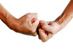 Fist fight. Two man's hands fighting against royalty free stock image