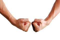 Fist fight. Two tight fists fighting against stock photo