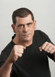 Fist fight man. Tough man ready to fight fists up Royalty Free Stock Image