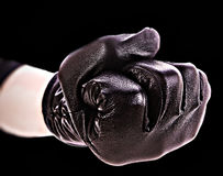 Fist in gloves on black Royalty Free Stock Image