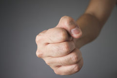 Fist on grey background. Close up fist on grey background Stock Images