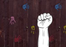 Fist hand against wooden background Stock Photos