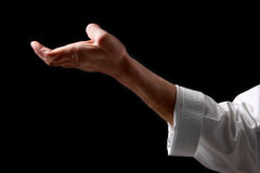 Fist. Hand fighter karate. On the black background Royalty Free Stock Images