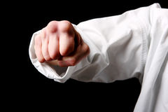 Fist. Hand fighter karate on the black Stock Image