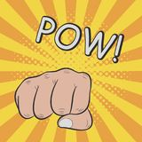 Fist hitting or punching. POW. Comic illustration in pop art retro style. Vector illustration. Stock Images