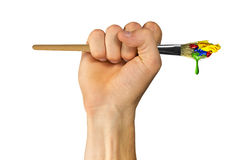 Fist holding paintbrush with paint Royalty Free Stock Photos