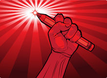 Fist holding a pencil with a fiery point Stock Photography