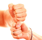 Fist. Image of male and female hands on top of each other Royalty Free Stock Photo