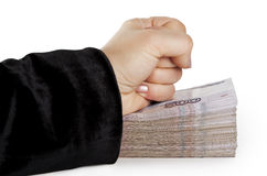 Fist on a large bundle of Russian money Stock Photos