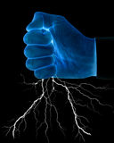 Fist with lightning Stock Image