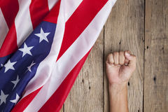 Fist man hand with United States of America flag on old wood bac Stock Image