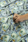 Fist on the money. Dollar banknotes stock photography