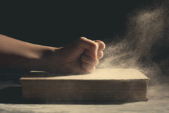 Fist on an old book. Royalty Free Stock Photo