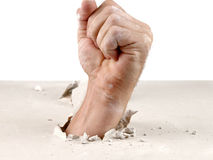 Fist out of wall Stock Photo